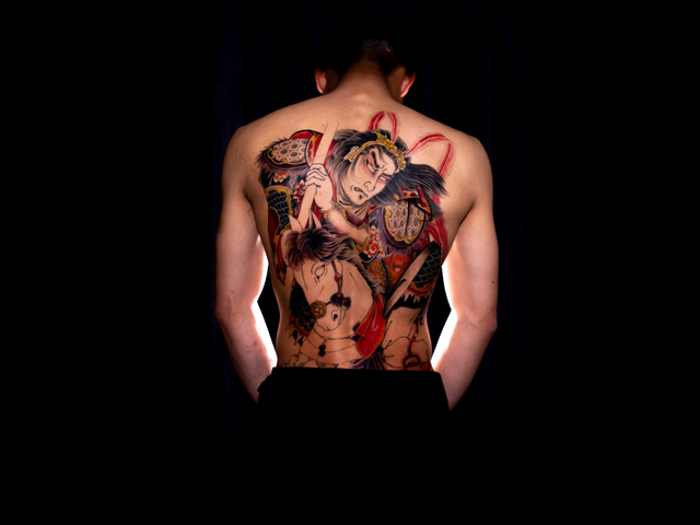Stereotypical image of a wabori tattoo that is more associated with the negative connotations and what yakuza would curve onto their body