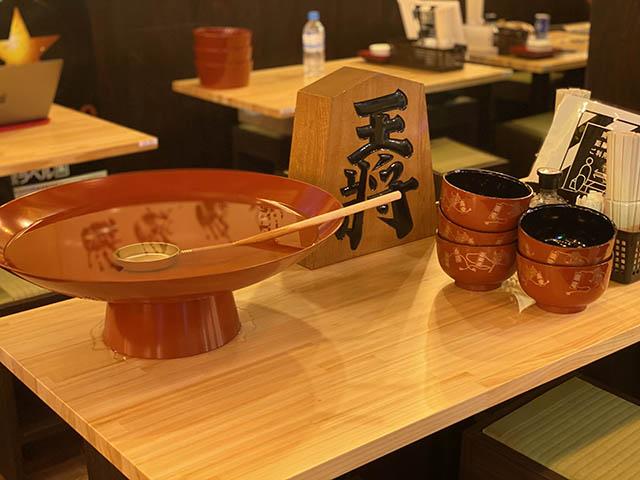 「力士めし萬」の横綱盃(米焼酎水割り)