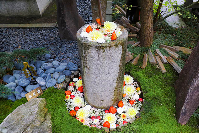 """""""Suikinkutsu (water koto cave)""""a type of Japanese garden ornament that creates a musical splashing sound placed inside the shrine"""