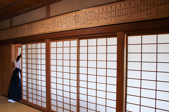 The scrolls with the etiquette written are displayed at a family dojo in Setagaya, Tokyo