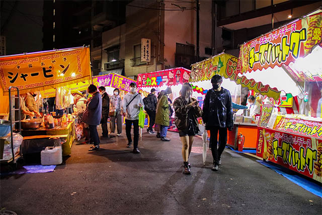 Food stalls are located on the street around the shrine